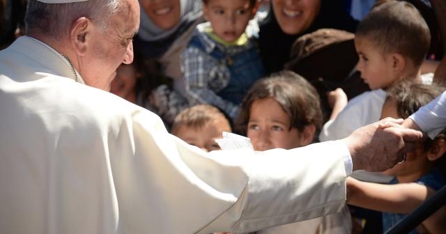 AP-Pope-Migrants